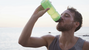 man hydrating from heat exhaustion